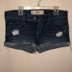 Ripped dark wash jean shorts